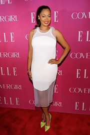 La La Anthony paired neon-yellow pointy pumps with a sheer-panel white dress for a modern finish at the Elle Women in Music celebration.