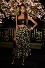 To add some feminine flare to her look, Jessica White opted for a black and gold floral skirt.