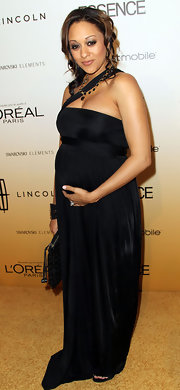 Tia was a glamorous momma-to-be in a black Grecian evening gown for the Essence Luncheon.