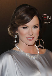 Danneel Harris paired her silver satin dress with a pearl necklace.