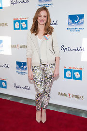 Jayma Mays opted for a sporty but feminine striped motorcycle jacket for her red carpet look.