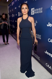 Salma Hayek showed off her fabulous body in a figure hugging blue racer-front dress with black lace side panels at the 4th Annual Sean Penn & Friends HELP HAITI HOME Gala.