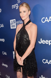 Charlize Theron opted for a fun LBD complete with lace detail and shimmering beadwork at the 4th Annual Sean Penn & Friends HELP HAITI HOME Gala.