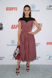 Emmy Rossum added more plaid with a Fendi purse.