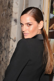 Izabel Goulart kept her look sleek and simple with a super straight ponytail.