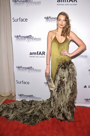 Eniko Mihalik looked totally glamorous with an olive green dress that featured a feathered train.