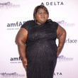 Gabourey Sidibe at the 2013 amfAR Inspiration Gala New York