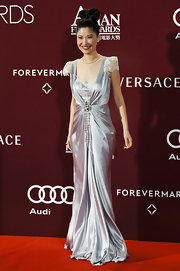 Angela Chow showed off her draped silver dress by pairing it with an elegant up-do bun.