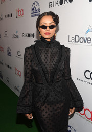 Kat Graham looked uber cool wearing these blade sunglasses at the Hollywood Beauty Awards.
