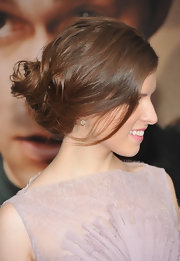 Anna Kendrick wore her hair in a casual version of the French twist at the premiere of '50/50'. To try her look, first add a little hairspray and backcomb hair ends to add some texture. Next, pull tresses back loosely to the nape of the neck and begin to twist hair vertically. To secure the twist, insert u-shaped bobby pins and finish by misting with hairspray.