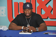 50 cent wore a NY Yankees baseball cap at a signing in New York City.