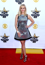 Reese Witherspoon teamed her fabulous dress with black gladiator heels by Jimmy Choo.