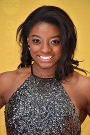 Simone Biles sported a teased 'do with curly ends at the CMA Awards.
