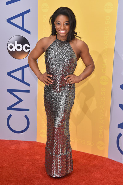 Simone Biles lit up the CMA Awards red carpet with this super-sparkly halter gown.