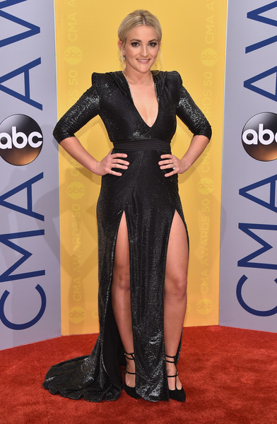 Jamie Lynn Spears went vampy in a shiny black gown with bold shoulders, a plunging neckline, and double slits for her CMA Awards look.