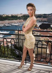Jacqueline MacInnes Wood paired gold evening sandals with a brocade dress for her portrait session at the Monte Carlo TV Festival.