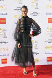 Letitia Wright went for flirty glamour in a sheer black tulle dress by Georges Chakra Couture at the 2019 NAACP Image Awards.