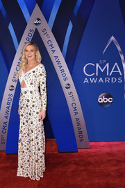 Kelsea Ballerini was all about modern glamour in a white Michael Kors gown with a midriff cutout and gold floral beading at the 2017 CMA Awards.