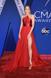 Danielle Bradbery looked ravishing in a high-slit red gown with a strappy neckline at the 2017 CMA Awards.