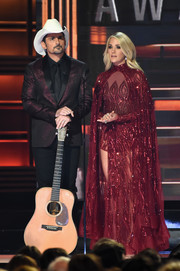 Carrie Underwood had all eyes on her when she wore this caped, beaded wine-red gown by Elie Madi during the CMA Awards show.