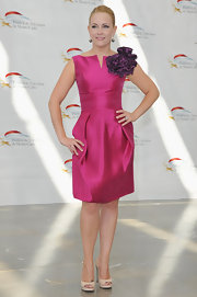 Melissa wore a hot fuchsia cocktail dress for the 'Melissa & Joey' photocall.