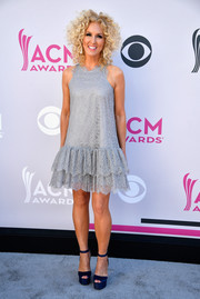 Kimberly Schlapman went for a girly vibe in a gray lace mini dress with a tiered ruffle hem at the 2017 ACM Awards.