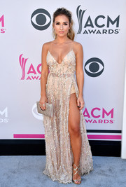Jessie James Decker paraded plenty of skin in a sheer, beaded Abyss by Abby gown with a plunging neckline and a high slit during the 2017 ACM Awards.