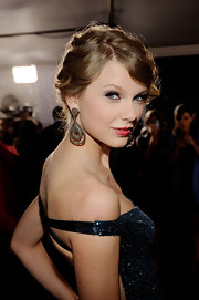 Taylor's stunning 12-carat diamond custom-made earrings put her sky rocketing success on full display. So fab!