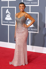 Melody showed off her curves in a beaded, form-fitting evening gown.