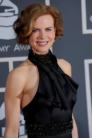Nicole Kidman graced the red carpet of the 2010 Grammy Awards with her beauty and style. Stunning in a black gown, Ms. Kidman chose  Fred Leighton's 19th Century diamond cluster and black enamel earrings as the perfect complements to her elegant attire.