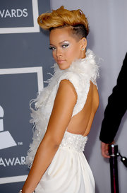 The always daring Rihanna sported a newly reconstructed faux hawk for the Grammys. This girl can pull off anything.