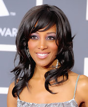 Shaun added a little bounce to her look with soft curls and side swept bangs.