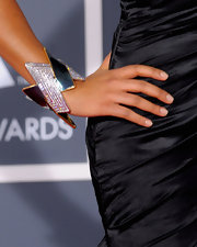 R&B singer Melanie Fiona shows off her diamond encrusted cuff bracelet, which reallt stands out against her black satin gown.
