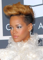 Rihanna showed off a star tattoo in her upper left ear, while at the Grammy Awards.