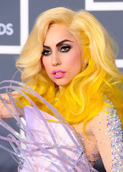 Lady Gaga paired her hot pink lips and vibrant yellow-blond hair with metallic gunmetal eyeshadow.
