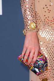 Katy rocks this jewel encrusted box clutch. You can always count on Katy to add an unexpected piece to her ensemble.