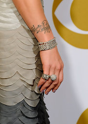 Pink jazzed up her crystal embellished gown with a few key jewelry pieces. SHe rocked major arm candy by sporting this diamond bracelet.