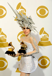 Lady Gaga loves her crazy hats! Here she wears an architectural inspired design.