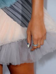 Rihanna rocked dollar bill printed minx nails to the 52nd Grammy Awards.