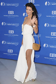 Jacqueline MacInnes Wood's white maxi dress looked seductive, thanks to its dangerously low neckline and thigh-high slit.