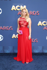 Miranda Lambert was bold with her colors, pairing her red dress with a magenta satin envelope clutch by Tyler Ellis.