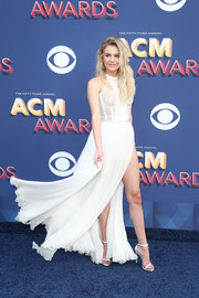Kelsea Ballerini matched her dress with white ankle-strap sandals by Stuart Weitzman.