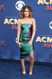 Maren Morris looked modern and elegant in an iridescent jewel-toned strapless dress by Christian Siriano at the 2018 ACM Awards.