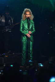 Kimberly Schlapman glowed onstage in an emerald-green jacquard suit by Gucci at the 2018 ACM Awards.