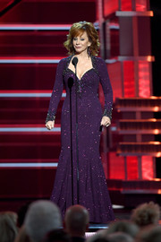 Reba McEntire sparkled onstage in a beaded purple gown by Johnathan Kayne at the 2018 ACM Awards.
