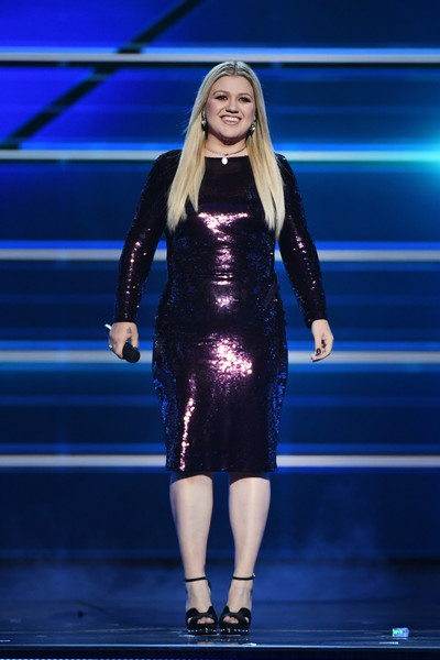 Kelly Clarkson styled her dress with a pair of black Alexander McQueen platforms.