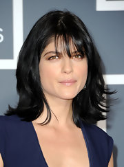 Selma Blair styled her raven locks in a sleek straight style complete with wispy bangs.