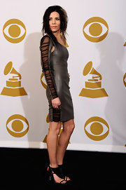 Skylar Grey completed her outfit with a pair of black cut-out booties.