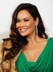 Tia Carrere was all about glamour at the Grammys with this long curly 'do and luxe accessories.