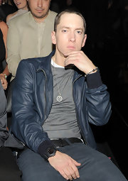 Eminem made a statement at the 53rd Annual Grammy Awards by wearing a gold illuminati triangle necklace.